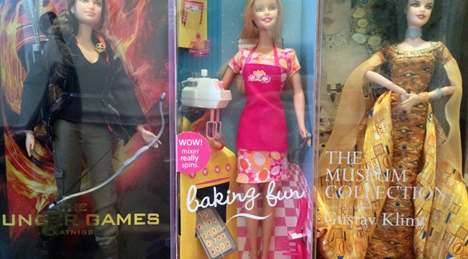 L-to-R: Katniss Barbie, Baking Fun Barbie, and Gustav Klimt Inspired Barbie.