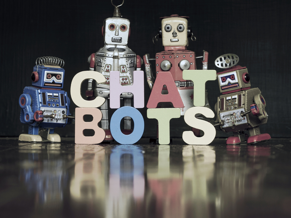the word  CHAT BOTS with retro robots on a wooden floor with reflection toned