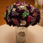 Broach bouquet in vase as centerpiece