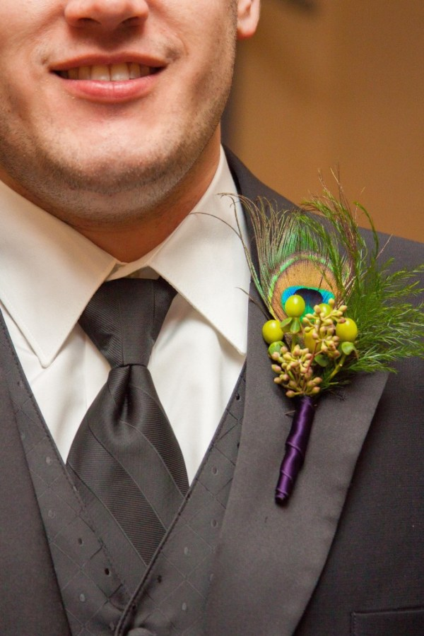 Peacock Theme Wedding Ideas. Peacock feather Mens boutonniere