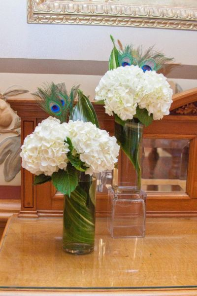 Peacock feathers and hydrangeas work well together for an elegant centerpiece