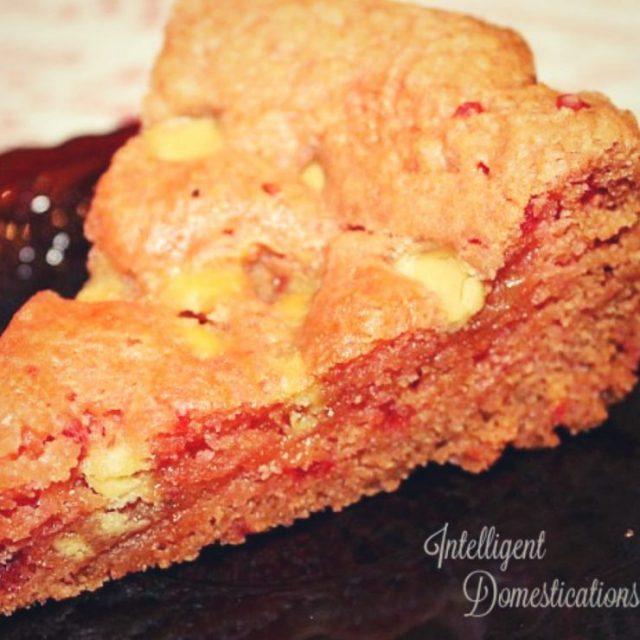 strawberry brownie on a dark plate