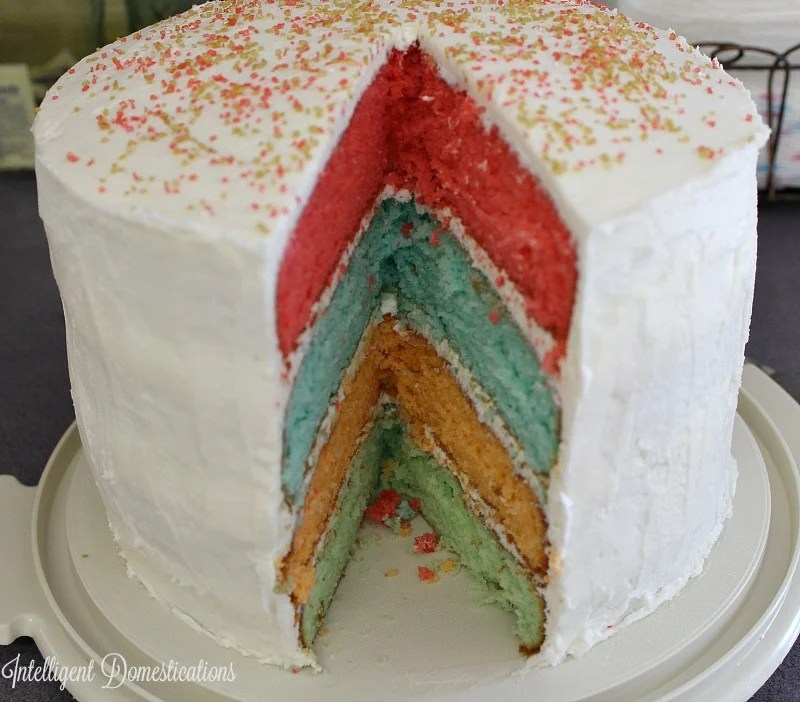 Rainbow layer cake is four layers of flavor and beauty. Perfect for Easter dessert.intelligentdomestications.com