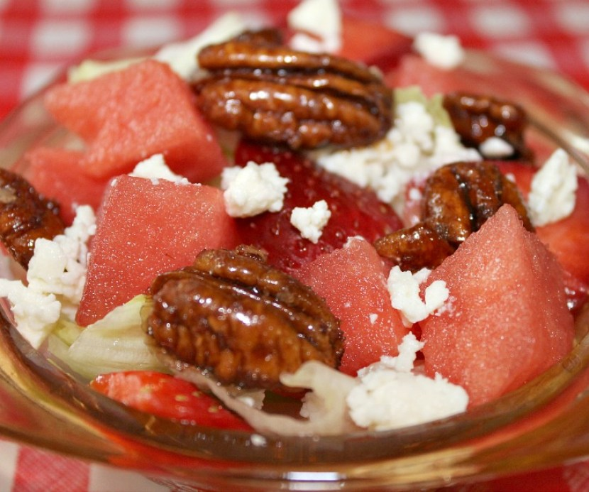 Watermelon salad with feta and candied pecans served in a small bowl
