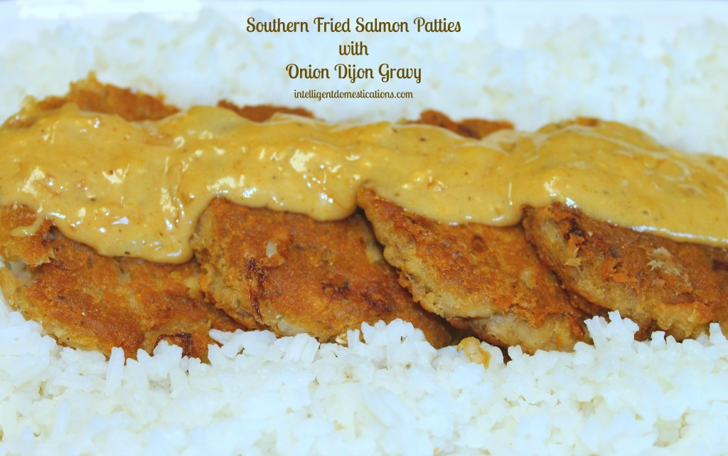 Southern Fried Salmon Patties with Onion Dijon Gravy served on a bed of rice