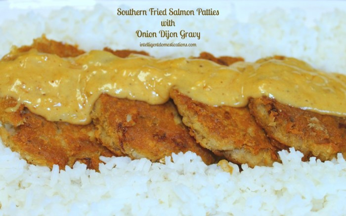 Southern Fried Salmon Patties with Onion Dijon Gravy served on a bed of rice.intelligentdomestications.com