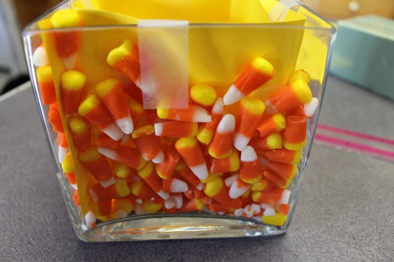 Place the candy corn between the glass and the cardstock.intelligentdomestications.com