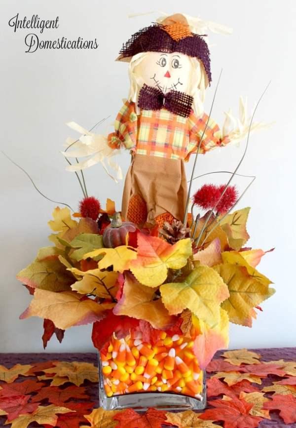 DIY Scarecrow Table Decor Dollar Store Craft. How to make this cute Scarecrow ceenterpiece using Dollar Tree supplies. #Scarecrow #falltabledecor