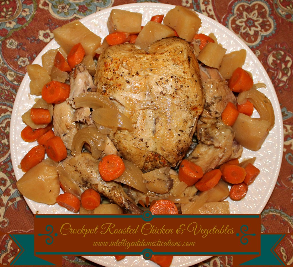 Crockpot Roasted Chicken and Vegetables served on a platter.intelligentdomestications.com