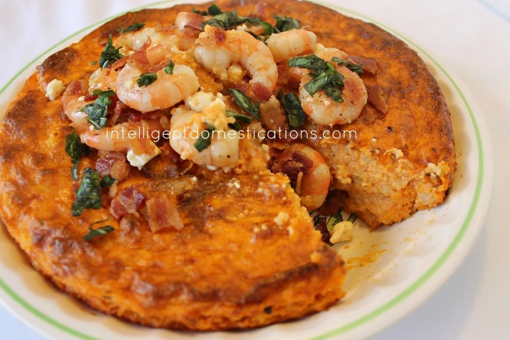 Southern Shrimp & Grits Pie.Imagine a flavor combination of cheeses, marinara, shrimp & basil infused with crockpot grits. A southern delicacy.intelligentdomestications.com
