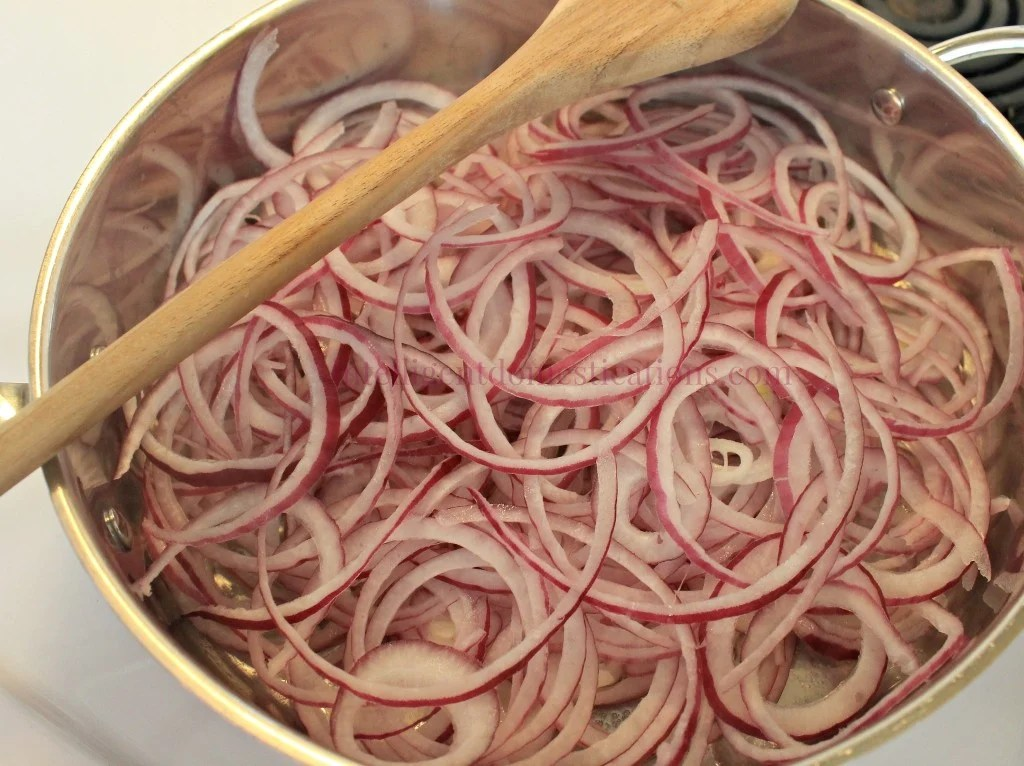 Start with a pan full of thin spiral cut red onions