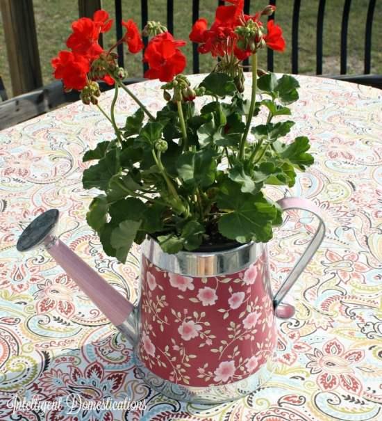 Decorative Watering Can Centerpiece. DIY Floral centerpiece. Mod Podge project