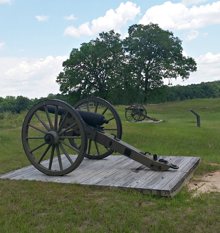 A pair of cannons pointed into the prison site to ward off an uprising at Andersonville Prison