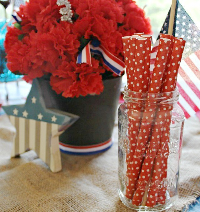 Create a fun and Simple Patriotic Table Decor using what you already have. This cute Red White and Blue Tablescape came together easily. See all of the little touches I have added. #patrioticdecor #redwhiteandblue #tabledecor