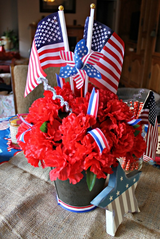Patriotic Centerpiece with red carnations in a metal bucket