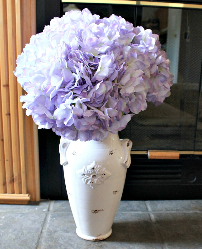 Giant Purple Hydrangea stems in a pretty porcelain chippy white vase bring summer indoors for summer den decor