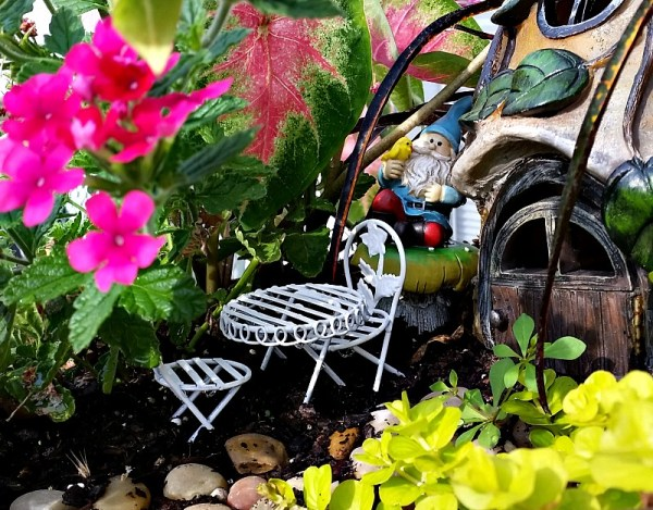 Our Fairy Garden Bistro set after makeover. My Fairy Garden Tour 2016. Fairy Garden Ideas. Flowers to use in a flower garden. #fairygarden #gnomes #fairygardenideas