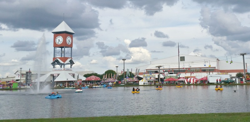 Ga.National Fair Perry Georgia view of the clock tower across the lake. The chair lifts are so fun and so are those paddle boats