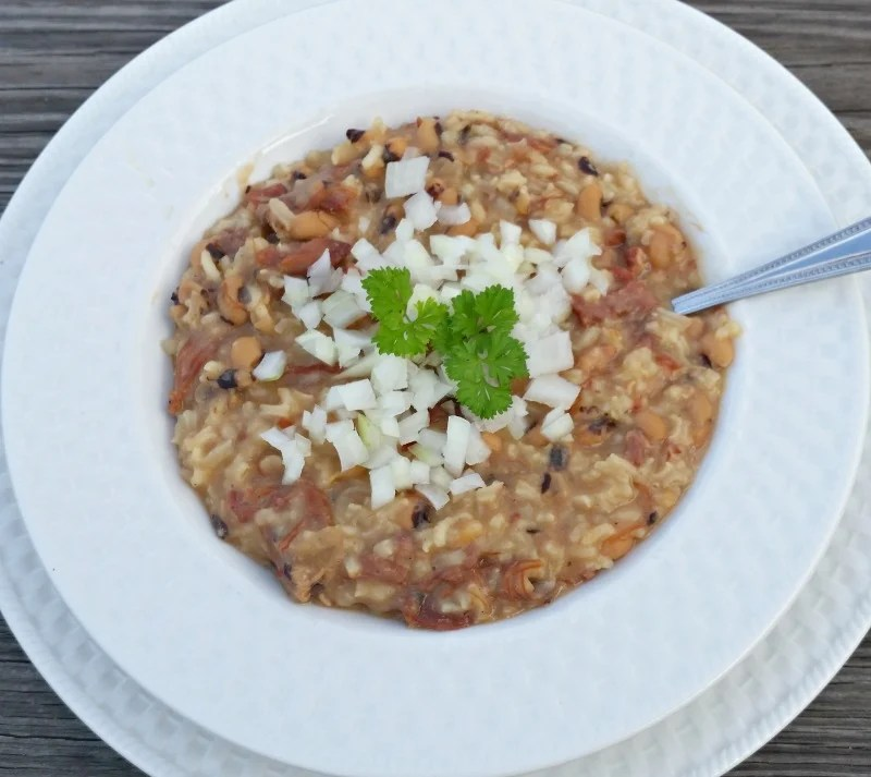 A nice hot bowl of Old Fashioned Southern Hoppin John is made with only three ingredients, peas, ham and water. Topping it with raw cut onions is optional
