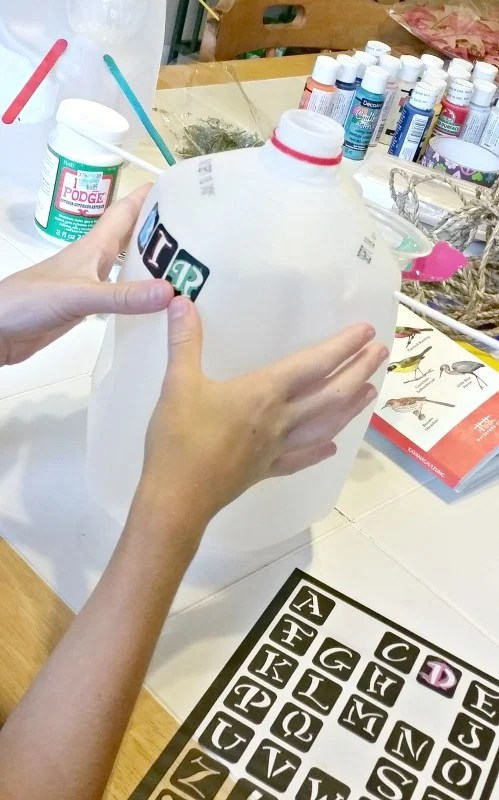 crafting-bird-houses-from-milk-jugs-those-peel-off-stencils-came-in-handy