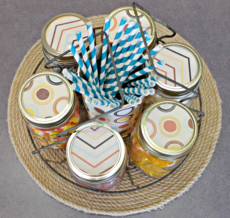 i-used-fall-design-craft-paper-to-add-some-fall-flair-to-the-mason-jar-lids-in-our-farmhouse-style-fall-candy-bar