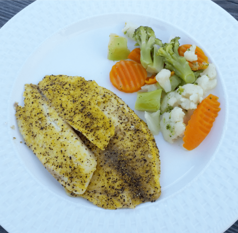 lemon-pepper-baked-tilapia-is-only-two-ingredients-to-the-table-and-served-with-boiled-california-vegetables-its-a-yummy-weeknight-dinner