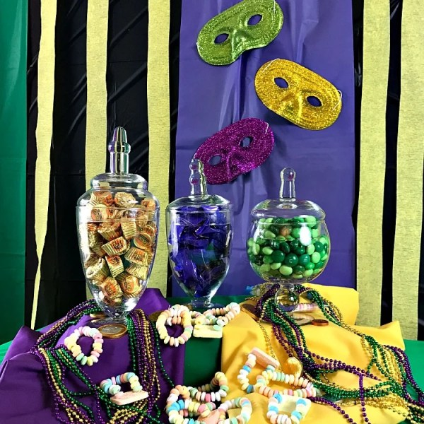 Mardi Gras Party Ideas. Family Friendly Mardi Gras Party Ideas. How to style candy glass jars for a party. Photo of a candy buffet. Mardi Gras Candy Buffet.