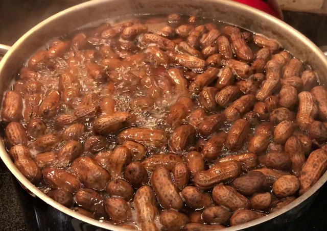How To Make Boiled Peanuts. It's a very simple recipe involving only 3 ingredients and one of those is water. Boiled peanuts are football food, baseball food, an appetizer or snack and even a good party food. You can cook boiled peanuts on your stove top at home! #footballfood #appetizer #boiledpeanuts