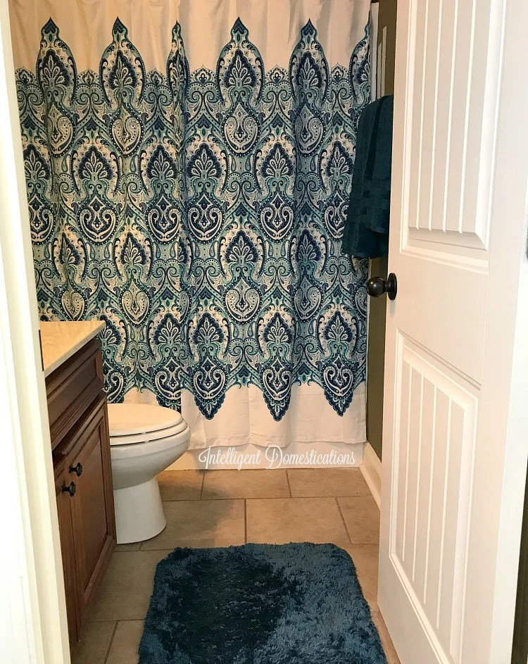 Perfect The shower curtain was a T J Maxx find We lucked up on matching towels and rug at Sam us Club Notice the two paint sample strips on the wall on the right