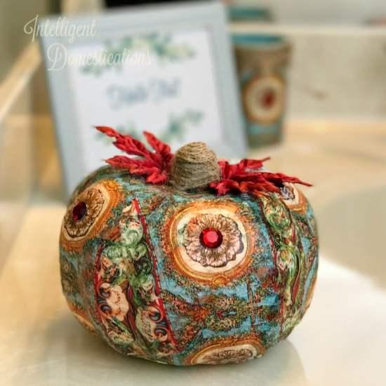 How to decoupage a pretty napkin onto a dollar store pumpkin. Dollar Store pumpkin makeover. Decoupage pumpkin. DIY Pumpkin craft idea.