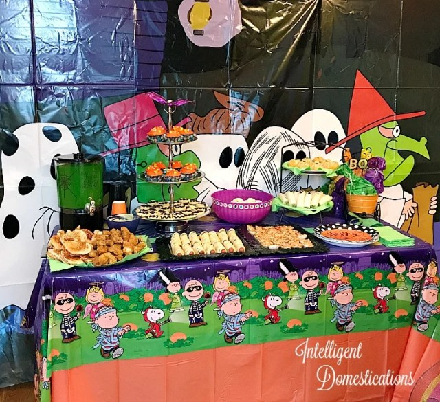Our Peanuts®️️️️️️Great Pumpkin Halloween party was super fun for children of all ages and the grown ups too! Charlie Brown Theme Halloween party ideas for a not so scary Halloween. Includes Free printable invitations, our Menu and Decor Ideas. #ad #charliebrown #halloween #trickortreat #games #family #invitations #peanutscharacters