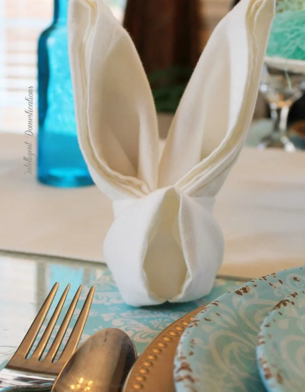 Simple Easter Table Decor. Easter Table Decorations. Easter Bunny Folded napkin for an Easter Table Setting