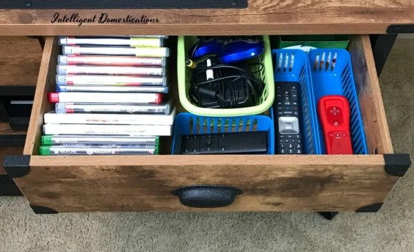 Using drawers to organize game system accessories and supplies. How I organized our game system accessories with drawers on a TV console.