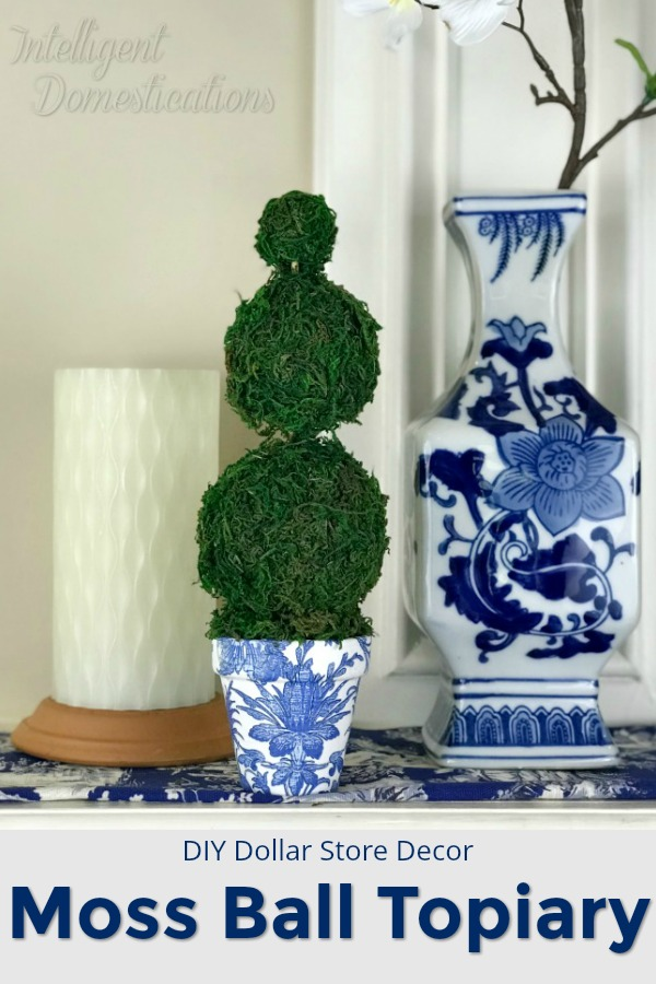 How to make a mini moss ball topiary using Dollar store supplies. Blue and White Moss Ball Topiary DIY project. Make your own blue and white decor vignette pieces. #mossballs #minitopiary #diytopiary #diydecor #dollarstorecraft