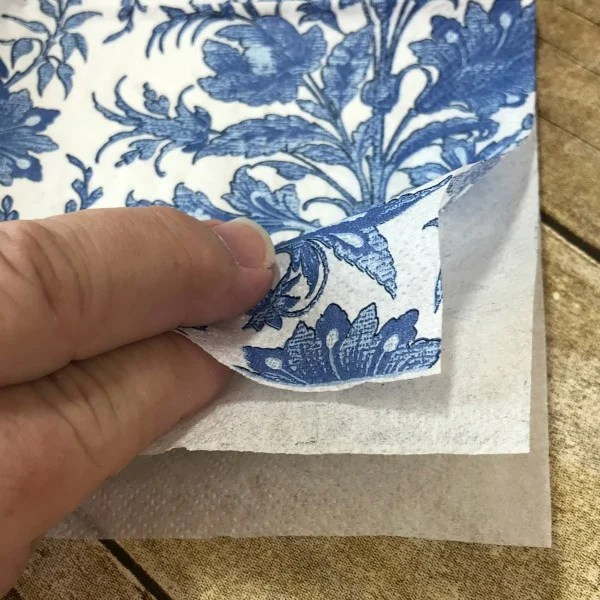 Separate the layers of napkins prior to using them for decoupage. Make your own Blue and White Orbs using napkins, Wiffle balls and decoupage. See how easy it is. DIY Orbs for home decor. How to make your own Orbs for staging bowls and trays. #diy #makeyourown #diyorb #diyblueandwhitedecor #howtostageabowl #homedecor
