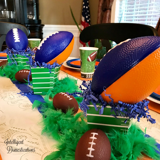 This Auburn color scheme football party table was created for a teen birthday celebration. These colors and ideas can be used for any team with Blue and Orange colors. Sports theme birthday party ideas. Blue and Orange Football Party Table Decor. SEC Football Party. #footballparty #blueandorangeparty #teenboyparty #teenbirthday #sec #Auburnparty #homegating #dollarstore #sporttheme #teamcolors