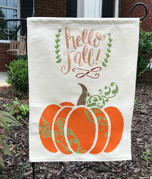 How to make a garden flag using drop cloth. Tutorial includes how to make a garden flag using a drop cloth, stencils and paint. Easy Fall Decor project and budget friendly.