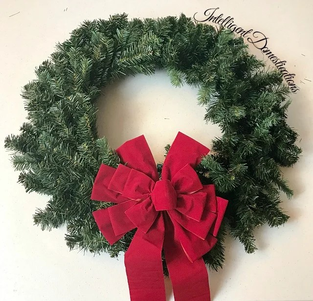an outside Christmas window wreath with a red bow