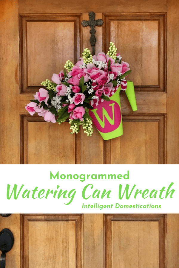 DIY Monogrammed Watering Can Wreath with bouquets of Roses spilling from the spout. I made this Spring wreath using Dollar Store supplies and my Cricut. It comes together in under one hour. Make this pretty Dollar store Spring Wreath for you home. #Wreath #diydecor #diywreath