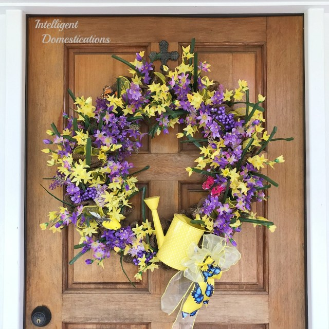 How To Make Your Own Summer Front Door Wreath. Step by step tutorial for making a pretty floral front door wreath for summer. Purple and Yellow Floral Summer Wreath Idea. #summerwreath #diywreath #floralwreath