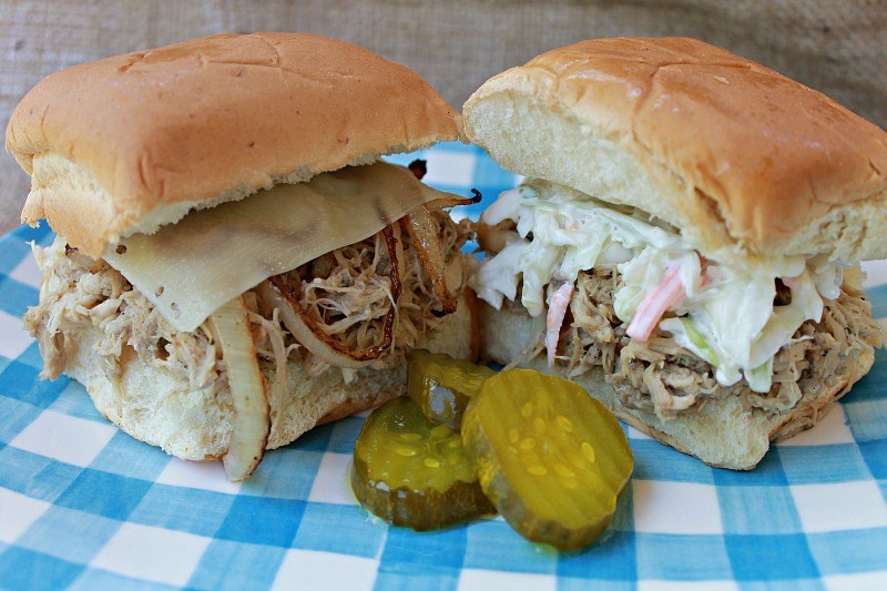 Chicken slider sandwiches with pickles on a plaid plate