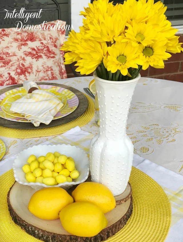 We created this Simple Lemon Tablescape for a late summer romantic soiree for two. My table decorations are simple and Mason Jars were perfect for our lemon infused water. Yes, those are Melamine dishes found! #lemontablescape #yellowtablescape #tabledecorations