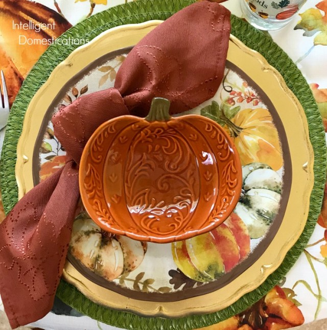 Our Autumn Tablescape showcases inexpensive Fall theme Melamine dishes with a Pumpkin soup bowl.