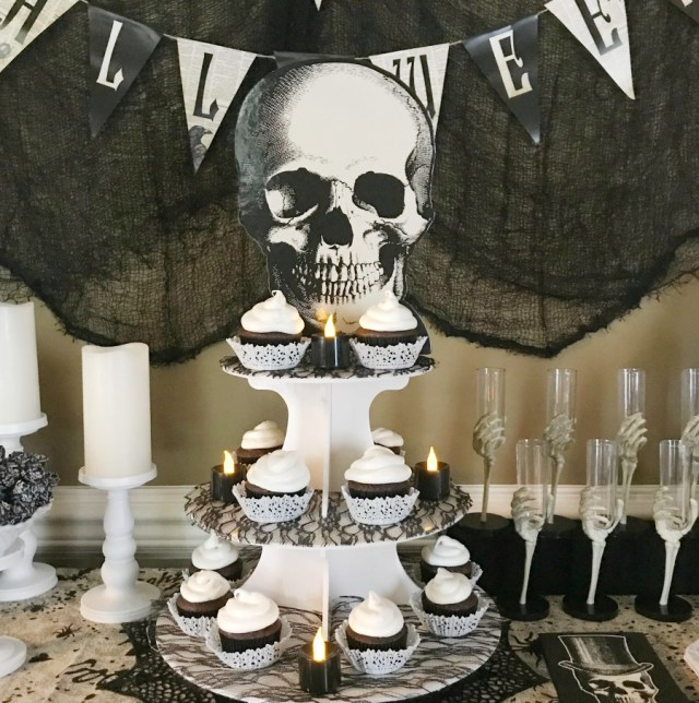 Skeleton Halloween Party Decorations. A Halloween fun party theme with skeleton decor in black, white and cream colors. Not too scary. #halloweenparty #skeletonparty