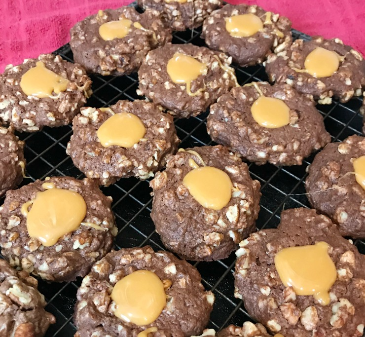 These made from scratch Chocolate Pecan Thumbprint cookies are light and soft with just the right amount of chewy. The cocoa powder makes them chocolate all the way through.