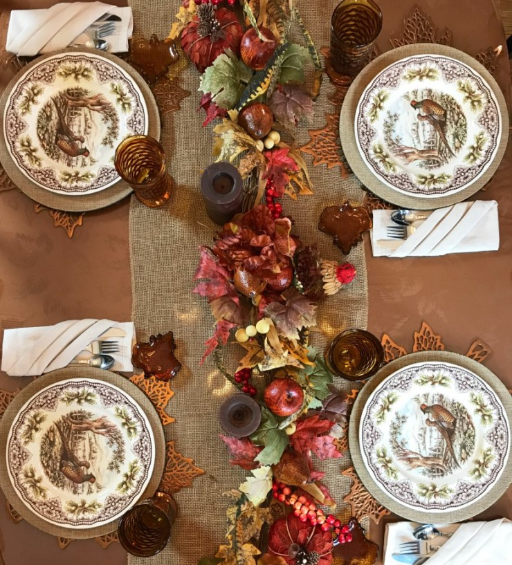 An overhead view of a table decorated for Thanksgiving