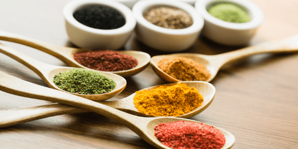 Fresh ground spices on small spoons