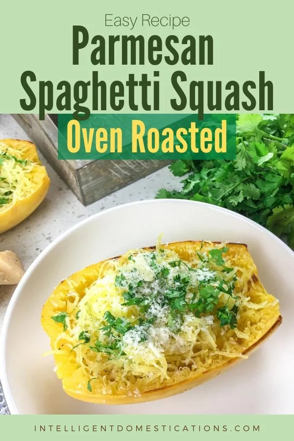 spaghetti squash cut in half and baked with cheese and parsley on top displayed on a white dish