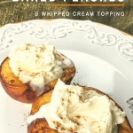Baked peach halves with whipped cream on top on a white plate