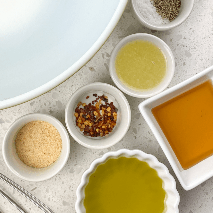 ingredients for shrimp penne pasta in small bowls